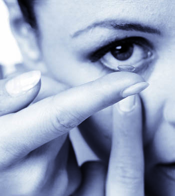 Woman Inserting Contact Lense