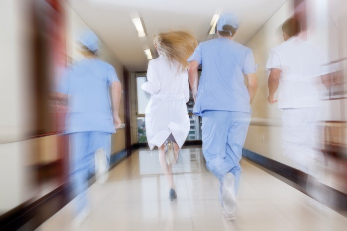 Doctor and nurse running in passageway